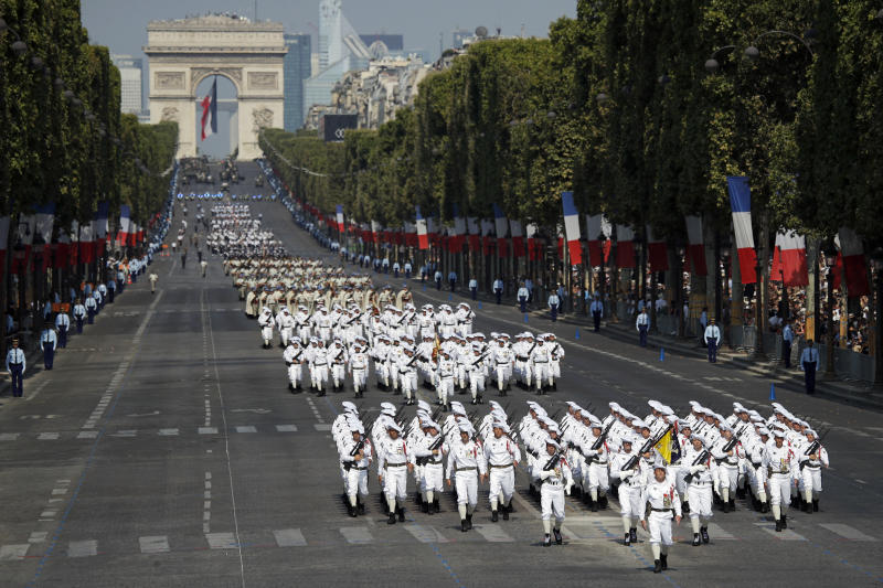 French troops march down the Champs Elysee avenue during the Bastille Day parade in Paris, France, Saturday, July 14, 2018. France's military is marching through Paris for Bastille Day celebrations and getting a budget boost from President Emmanuel Macron. (AP Photo/Francois Mori)