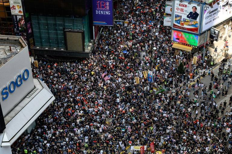 Protesters march in the Causeway Bay district of Hong Kong