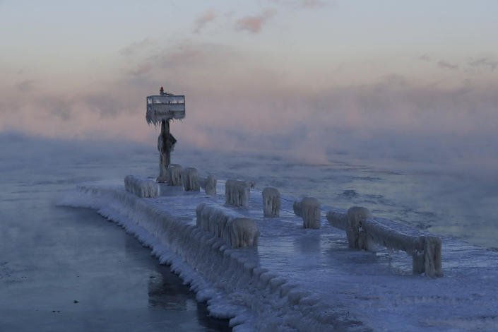 A harbor light is covered with snow and ice on the Lake Michigan at 39th Street Harbor, Jan. 30, 2019, in Chicago. (Photo: Nam Y. Huh/AP)