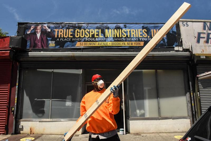 A worker grasps a piece of wood for a project in a church in Brownsville.