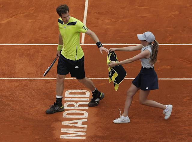 Andy Murray from Britain gets a towel from a ball girl during a Madrid Open tennis tournament match against Santiago Giraldo from Colombia in Madrid, Spain, Thursday, May 8, 2014. (AP Photo/Andres Kudacki)