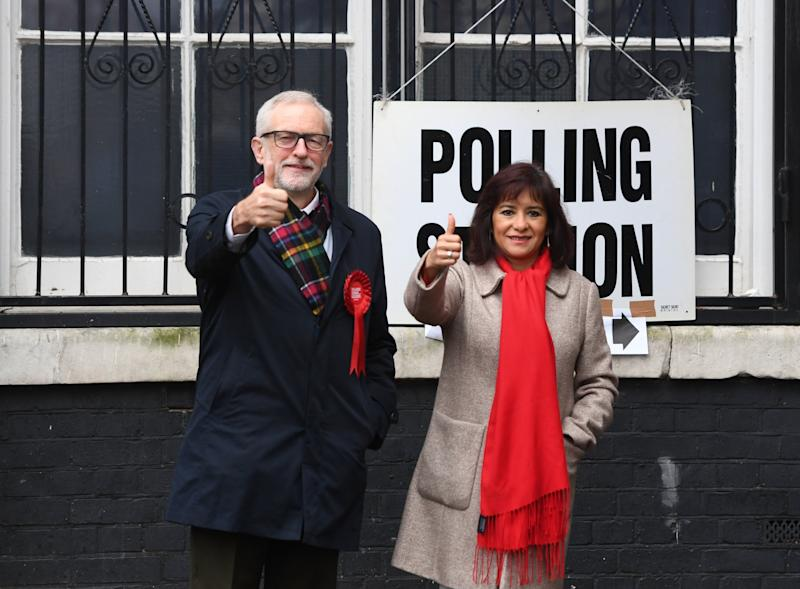 Jeremy Corbyn and his wife Laura Alvarez on polling day (PA)