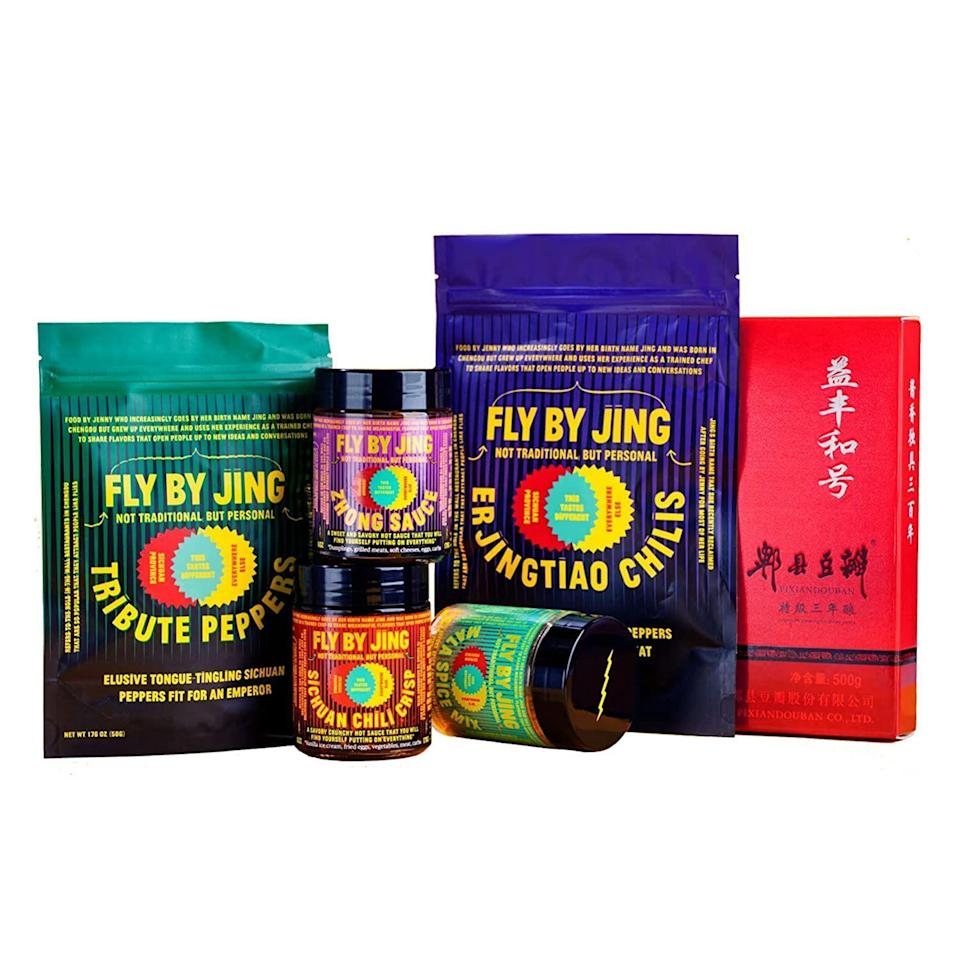 """<p><strong>FLYBYJING</strong></p><p>amazon.com</p><p><strong>$90.00</strong></p><p><a href=""""https://www.amazon.com/dp/B093WW755Z?tag=syn-yahoo-20&ascsubtag=%5Bartid%7C2140.g.33628308%5Bsrc%7Cyahoo-us"""" rel=""""nofollow noopener"""" target=""""_blank"""" data-ylk=""""slk:Shop Now"""" class=""""link rapid-noclick-resp"""">Shop Now</a></p><p>Ready to turn up the heat? This gift set includes ingredients that can be tricky to find in stores and is perfect for the fam to spice up their meals according to their preferred heat level. </p>"""