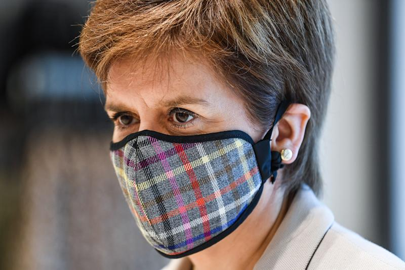 First Minister Nicola Sturgeon, wearing a Tartan face mask during a visit to New Look at Ford Kinaird Retail Park in Edinburgh.