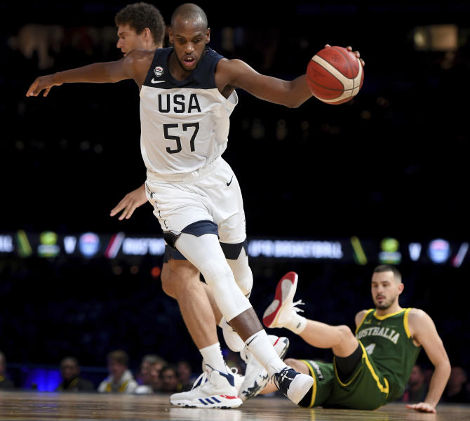 United States' Khris Middleton dribbles past during their exhibition basketball game against Australia in Melbourne, Thursday, Aug. 22, 2019. (AP Photo/Andy Brownbill)