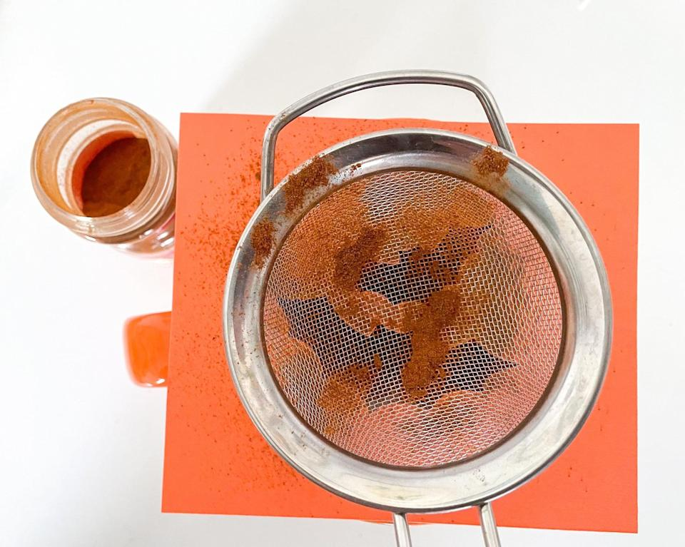 """<p>Finally, I used a small sifter to gently dispense cinnamon over the image. I also had good luck gently sprinkling cinnamon over the image by hand. Note: If you're trying this <a class=""""link rapid-noclick-resp"""" href=""""https://www.popsugar.com/latest/DIY"""" rel=""""nofollow noopener"""" target=""""_blank"""" data-ylk=""""slk:DIY"""">DIY</a> for the first time, I recommend using a stencil design that isn't incredibly intricate, as it's easier to evenly distribute the cinnamon over a simple image.</p>"""