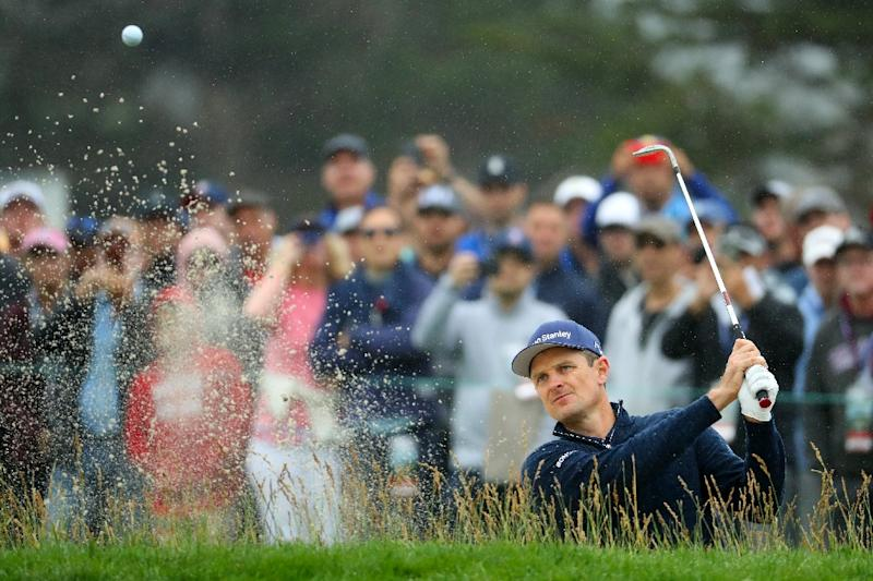 England's Justin Rose plays a shot from a bunker on the 12th hole during the second round of the 2019 US Open at Pebble Beach (AFP Photo/Warren Little)