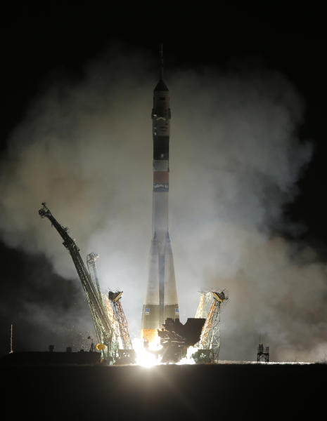 The Soyuz-FG rocket booster with Soyuz TMA-08M space ship carrying a new crew to the International Space Station (ISS), blasts off at the Russian leased Baikonur Cosmodrome, Kazakhstan, Friday, March 29, 2013. The Russian rocket carries Russian cosmonauts Alexander Misurkin, Pavel Vinogradov and U.S. astronaut Christopher Cassidy (AP Photo/Dmitry Lovetsky)