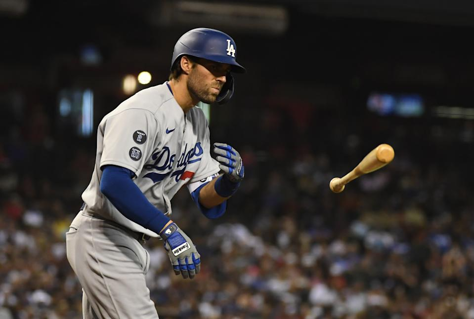 Chris Taylor of the Los Angeles Dodgers tosses his bat during a win last week over Arizona. (Photo by Norm Hall/Getty Images)