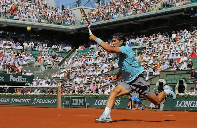 Spain's Rafael Nadal returns the ball to Britain's Andy Murray during their semifinal match of the French Open tennis tournament at the Roland Garros stadium, in Paris, France, Friday, June 6, 2014. (AP Photo/Michel Spingler)