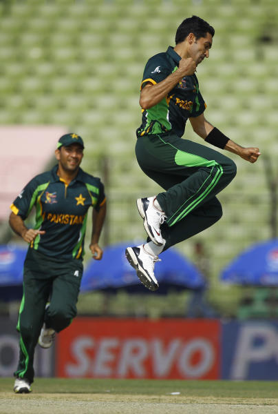Pakistan's Umar Gul jumps to celebrate the wicket of Sri Lanka's Kusal Perera during the opening match of their Asia Cup one-day international cricket in Fatullah, near Dhaka, Bangladesh, Tuesday, Feb. 25, 2014. (AP Photo/A.M. Ahad)
