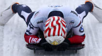 Katie Uhlaender, of the United States, reacts at the end of her run during the women's skeleton race at the Bobsleigh and Skeleton World Championships in Altenberg, Germany, Friday, Feb.12, 2021. (AP Photo/Matthias Schrader)