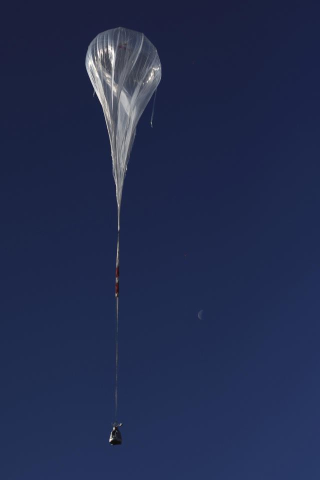 In this photo provided by Red Bull Stratos, the balloon carrying Felix Baumgartner ascends during the first manned test flight for Red Bull Stratos in Roswell, N.M. on Thursday, March 15, 2012. Baumgartner is more than halfway toward his goal of setting a world record for the highest jump. A spokesperson says the skydiver took a practice jump from more than 13 miles high over New Mexico. He's aiming for nearly 23 miles in the summer. The record is held by Joe Kittinger who jumped from 19.5 miles in 1960. (AP Photo/Red Bull Stratos, Joerg Mitter)
