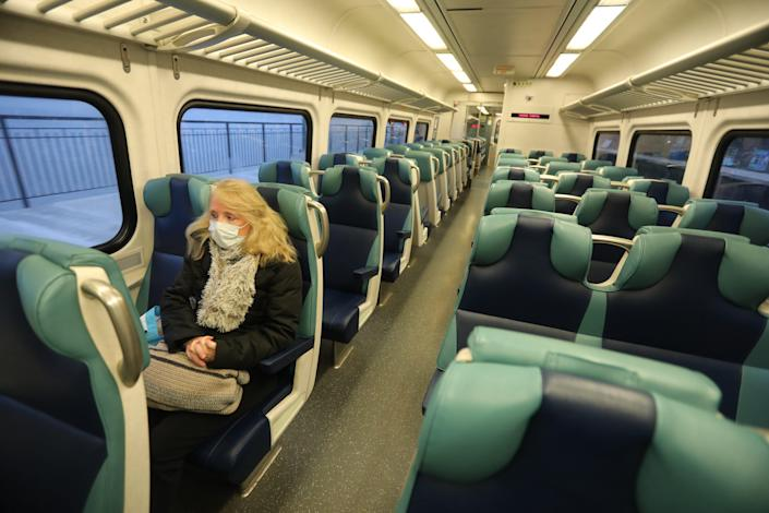 Lori Glazer of Ossining, N.Y., rides the empty local 7:14 a.m. Metro-North train in to New York City during what would typically be morning rush hour on March 25. Glazer is a registered nurse in the Children's Hospital at New York-Presbyterian/Columbia University Medical Center.