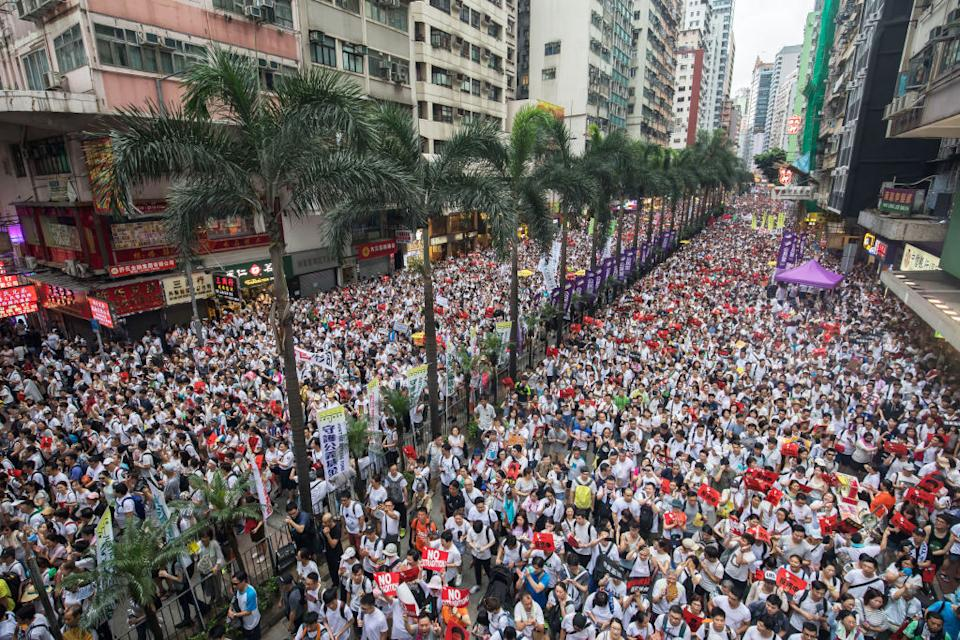 """Demonstrators march during a protest against a proposed extradition law in Hong Kong, China, on Sunday, June 9, 2019.span class=""""copyright""""Paul Yeung/Bloomberg via Getty Images/span"""