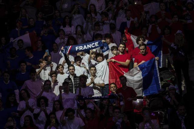EDS NOTE : SPANISH LAW REQUIRES THAT THE FACES OF MINORS ARE MASKED IN PUBLICATIONS WITHIN SPAIN France supporters cheer during the Davis Cup tennis match between Jo-Wilfried Tsonga and Serbia's Filip Krajinovic in Madrid, Spain, Thursday, Nov. 21, 2019. (AP Photo/Bernat Armangue)