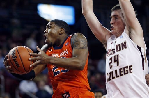 Auburn's Frankie Sullivan (23) drives to the basket past Boston College's Dennis Clifford (24) in the first half of an NCAA college basketball game in Boston, Wednesday, Nov. 21, 2012. (AP Photo/Michael Dwyer)