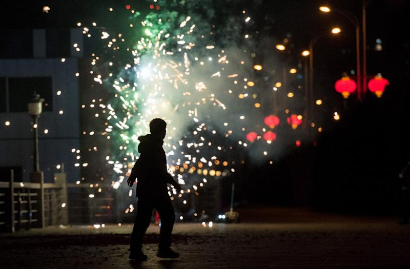 A man sets off fireworks to celebrate the Lunar New Year