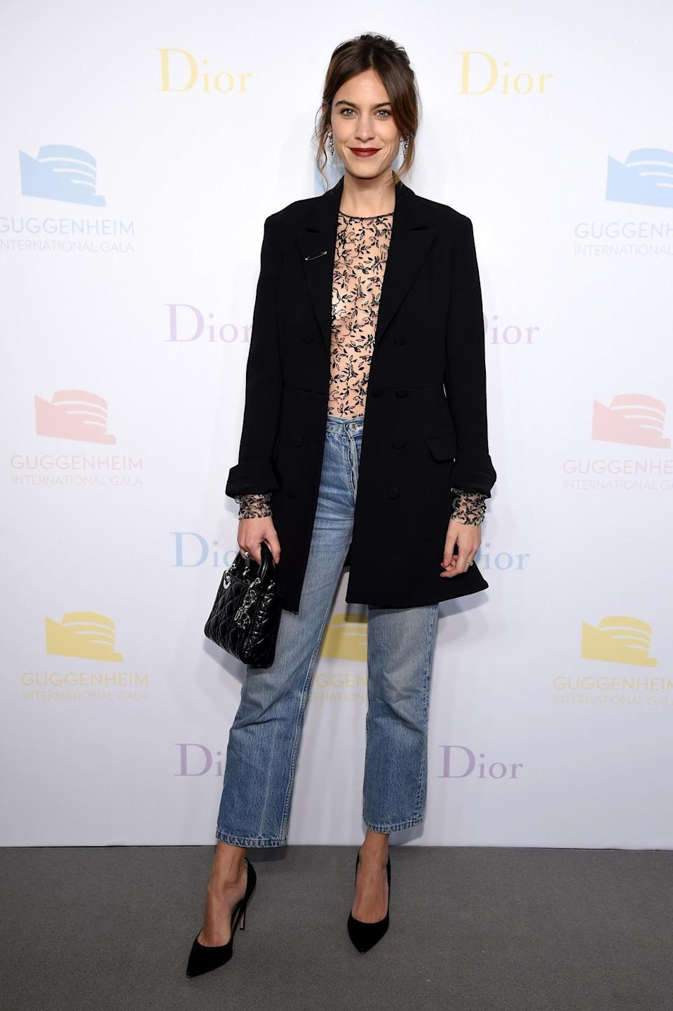 <p>Alexa gave a lesson in casual dressing in blue jeans, a sheer printed top and tailored black coat paired with a cute mini Dior bag. <i>[Photo: Getty]</i> </p>