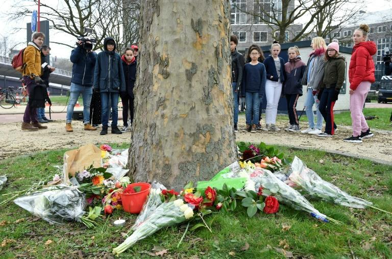 Mourners laid flowers at the site of the tram shooting in the Dutch city of Utrecht