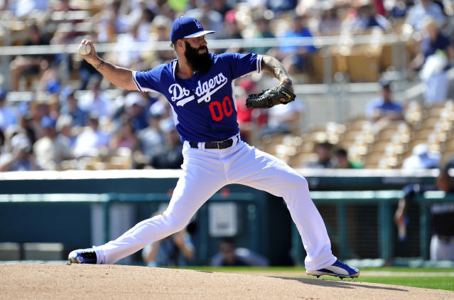 Brian Wilson is throwing a knuckleball now, because of course he is