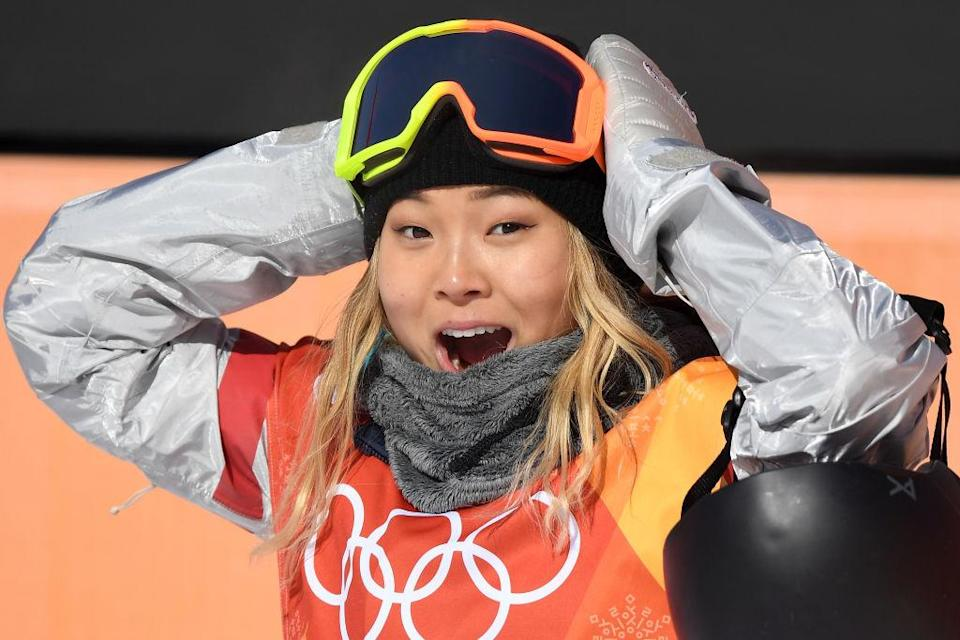 Chloe Kim celebrates after her first run in the finals of the women's halfpipe. (Getty)
