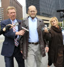 James Stevens, center, father of Conner Stevens, leaves US Federal Court Tuesday, May 1, 2012, in Cleveland. Conner Stevens, along with four others, is accused of plotting to blow up a bridge near Cleveland, the FBI announced Tuesday. (AP Photo/Tony Dejak)