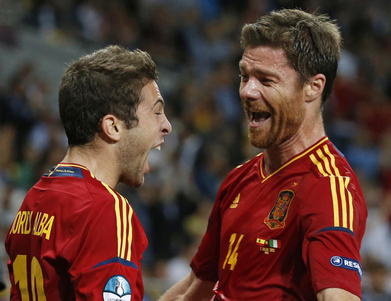 Spain's Jordi Alba, left, celebrates with his teammate Xabi Alonso after scoring his side's second goal during the Euro 2012 soccer championship final between Spain and Italy in Kiev, Ukraine, Sunday, July 1, 2012. (AP Photo/Jon Super)
