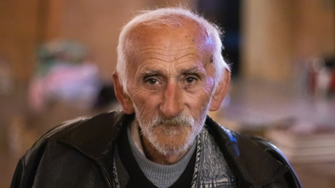 """<div class=""""inline-image__caption""""> <p>77-year-old Albert Tonyan is one of the people who have decided to stay in Stepanakert while his son is fighting on the frontline. He blames Turkey for the war.</p> </div> <div class=""""inline-image__credit""""> Emil Filtenborg </div>"""
