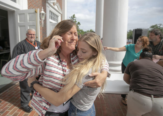 <p>Judge Sarah Ritterhoff Williams embraces family friend student Attie French after finding her in the crowd at First Baptist Church while looking for her own daughter following a shooting at Forest High School, Friday 20, 2018 in Ocala, Fla. (Photo: Alan Youngblood/Star-Banner via AP) </p>