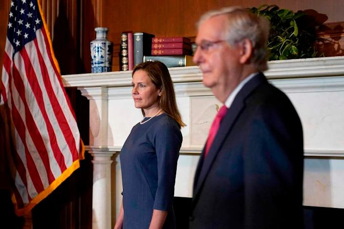 Supreme Court nominee Amy Coney Barrett meets with Senate Majority Leader Mitch McConnell, R-Ky., on Capitol Hill in Washington on Sept. 29. Confirmation hearings will start Oct. 12.