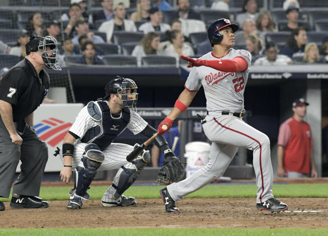 Washington Nationals' Juan Soto watches his home run in front New York Yankees catcher Austin Romine (28) and umpire Brian O'Nora uring the seventh inning of a baseball game Wednesday, June 13, 2018, at Yankee Stadium in New York. (AP Photo/Bill Kostroun)