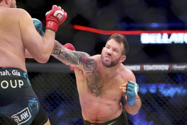 Ryan Bader beat Matt Mitrione (L) to advance to the Bellator heavyweight grand prix final. (AP Photo/Gregory Payan)