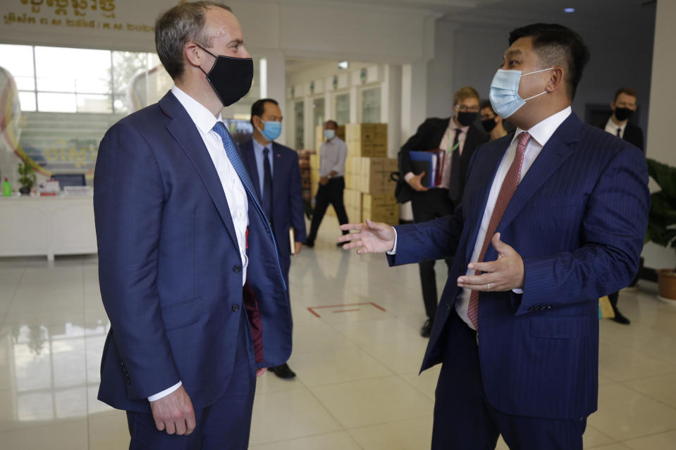 Britain's Foreign Secretary Dominic Raab, left, talks with Cambodian's Environment Minister Say Sam Al after a meeting in Phnom Penh, Cambodia Wednesday, June 23, 2021. Raab is on his two-day official visit to Cambodia. (AP Photo/Heng Sinith)