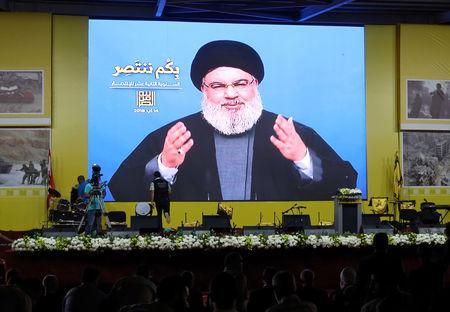 Lebanon's Hezbollah leader Sayyed Hassan Nasrallah gestures as he addresses his supporters via a screen in Beirut, Lebanon August 14, 2018. REUTERS/Aziz Taher