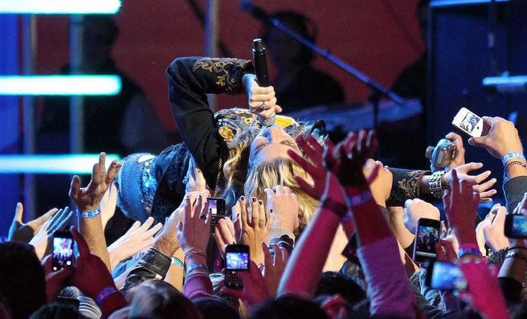 """While crowd surfing, Ke$ha's fans all made to capture the moment on their digital devices. """"OMG! I just touched Ke$ha!"""" Jean Baptiste Lacroix/<a href=""""http://www.wireimage.com"""" target=""""new"""">WireImage.com</a> - November 22, 2010"""