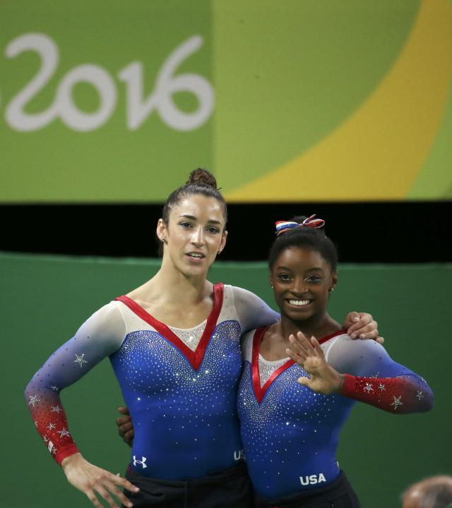 2016 Rio Olympics - Artistic Gymnastics - Final - Women's Floor Final - Rio Olympic Arena - Rio de Janeiro, Brazil - 16/08/2016. First placed Simone Biles (USA) of USA and second placed Alexandra Raisman (USA) of USA (Aly Raisman) react. REUTERS/Ruben Sprich FOR EDITORIAL USE ONLY. NOT FOR SALE FOR MARKETING OR ADVERTISING CAMPAIGNS.
