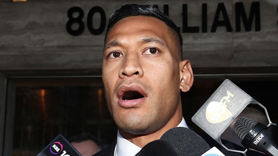 Israel Folau is seen here speaking at a press conference outside court.