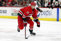 Carolina Hurricanes' Sebastian Aho (20), of Finland, brings the puck up the ice against the Ottawa Senators during the second period of an NHL hockey game in Raleigh, N.C., Monday, Nov. 11, 2019. (AP Photo/Karl B DeBlaker)