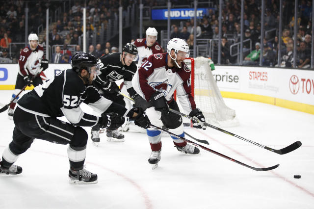 Colorado Avalanche's Patrik Nemeth, right, of Sweden, moves the puck away from Los Angeles Kings' Michael Amadio during the second period of an NHL hockey game, Monday, April 2, 2018, in Los Angeles. (AP Photo/Jae C. Hong)