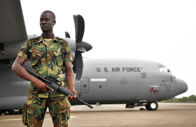 A member of the Ghanaian air force guards a U.S. Air Force C-130J Hercules during the capstone event of African Partnership Flight 12-2.