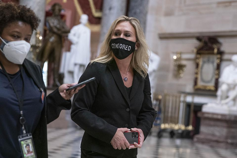 Representative Marjorie Taylor Greene, a Republican from Georgia, speaks to a member of the media as she walks through Statuary Hall in the U.S. Capitol in Washington, D.C., U.S., on Wednesday, Jan. 13, 2021. (Sarah Silbiger/Bloomberg via Getty Images)