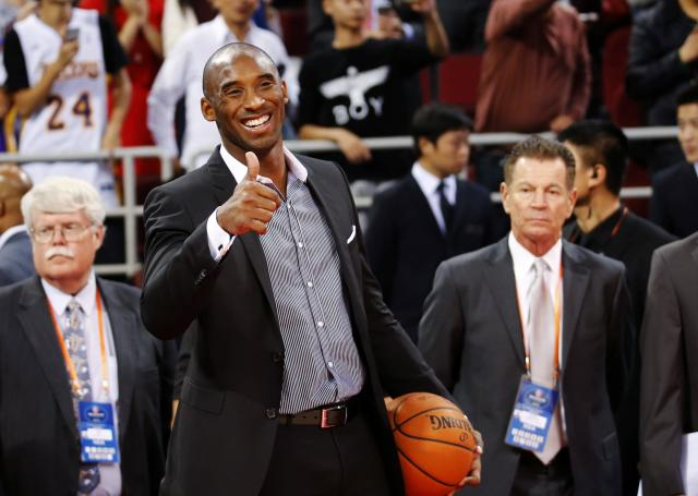 Los Angeles Lakers' Kobe Bryant gestures to his teammates before their game against the Golden State Warriors at the NBA Global Games in Beijing, October 15, 2013. REUTERS/Kim Kyung-Hoon (CHINA - Tags: SPORT BASKETBALL)