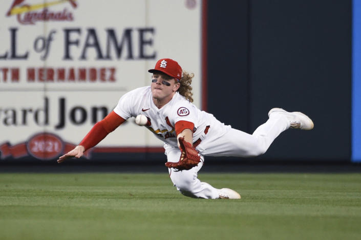 St. Louis Cardinals center fielder Harrison Bader catches a fly ball hit by Chicago Cubs' Nico Hoerner during the seventh inning of a baseball game Thursday, July 22, 2021, in St. Louis. (AP Photo/Joe Puetz)
