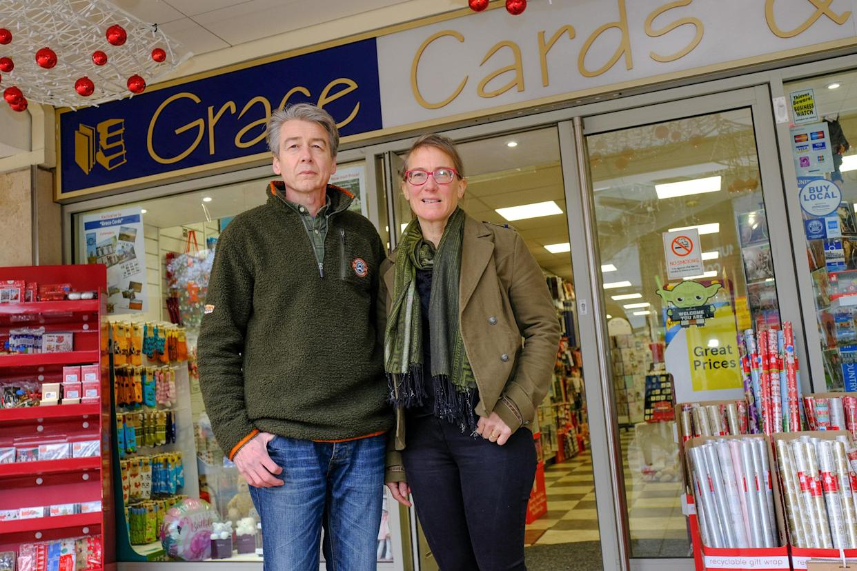 Alasdair, 54, and wife Lydia Walker-Cox, 50, kept their card shop open during lockdown. (SWNS)