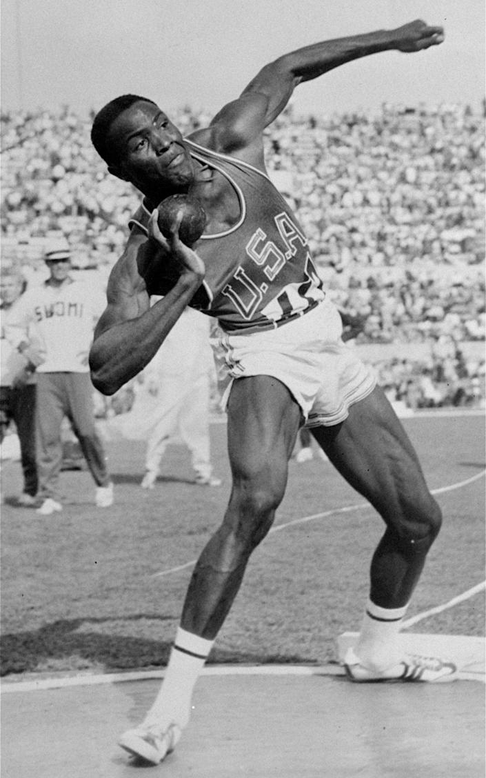 Johnson competing in the Olympic decathlon shot put in Rome - AP