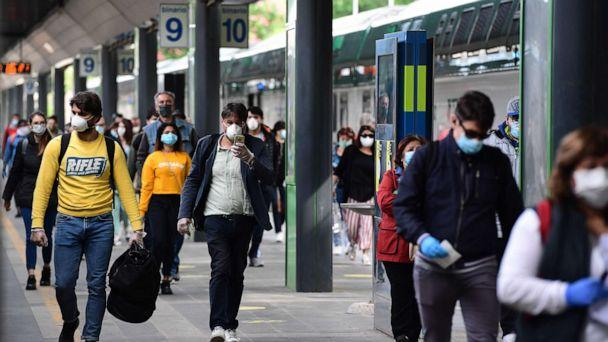 PHOTO: Commuters arrive from a regional train at the Cardona railway station in Milan on May 4, 2020, as Italy starts to ease its lockdown aimed at curbing the spread of the novel coronavirus. (Miguel Medina/AFP via Getty Images)