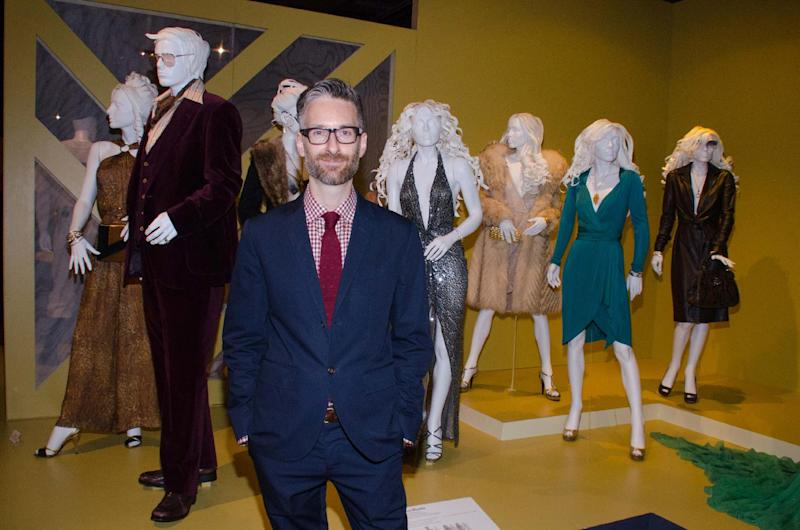 "In this Saturday, Feb. 8, 2014 photo, costume designer Michael Wilkinson attends the 22nd annual Art of Motion Picture Costume Design Exhibit, in Los Angeles, Calif. Wilkinson's costumes for the film ""American Hustle,"" are nominated for an Academy Award. The Fashion Institute of Design & Merchandising holds its free-to-the-public Art of Motion Picture Costume Design exhibit on view until April 26, 2014, featuring this year's five Oscar nominees: ""American Hustle,"" ""The Grandmaster,"" ""The Great Gatsby,"" ""The Invisible Woman"" and ""12 Years A Slave,"" in Los Angeles. (Photo by Tonya Wise/Invision/AP)"