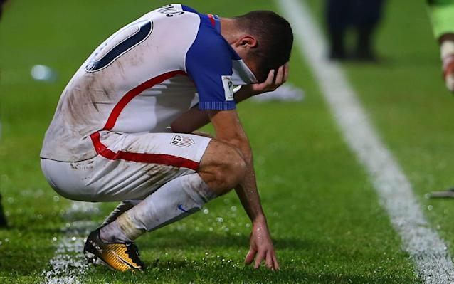 Christian Pulisic reacts after the U.S. team's stunning loss to Trinidad and Tobago on Tuesday night. (Getty)
