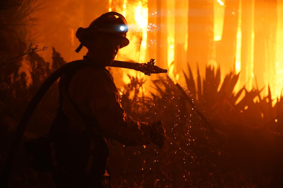 BOULDER CREEK, CA - August 22: Firefighters work to protect homes surrounding residences engulfed in flames on Madrone Ave at the corner of Virginia Ave before 2 a.m. in Boulder Creek, Calif., on Friday, August 22, 2020. (Photo by Dylan Bouscher/MediaNews Group/The Mercury News via Getty Images)